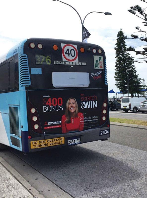 MHIAA Escape the Heat Promotion – Transit – Bus Advertising using Tara Dennis for Mitsubishi Summer promotion | Trade Advertising